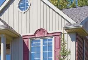 House with KP vinyl vertical sidings